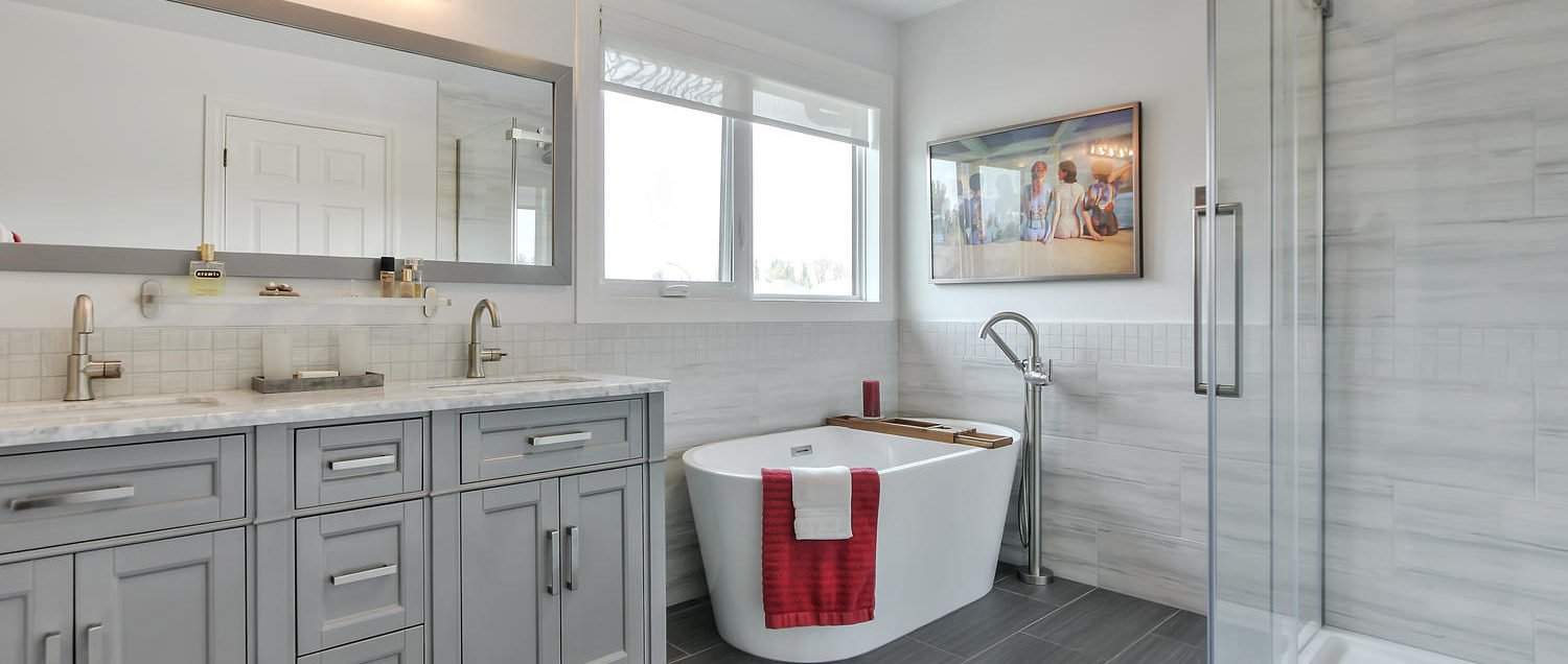 Custom Edmonton ensuite bathroom with free-standing soaker tub