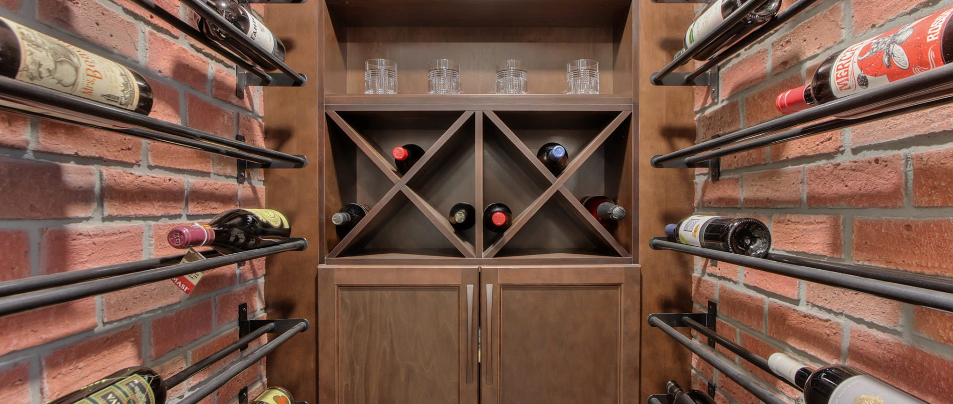Edmonton home basement renovation with complete faux-brick-finished wine room